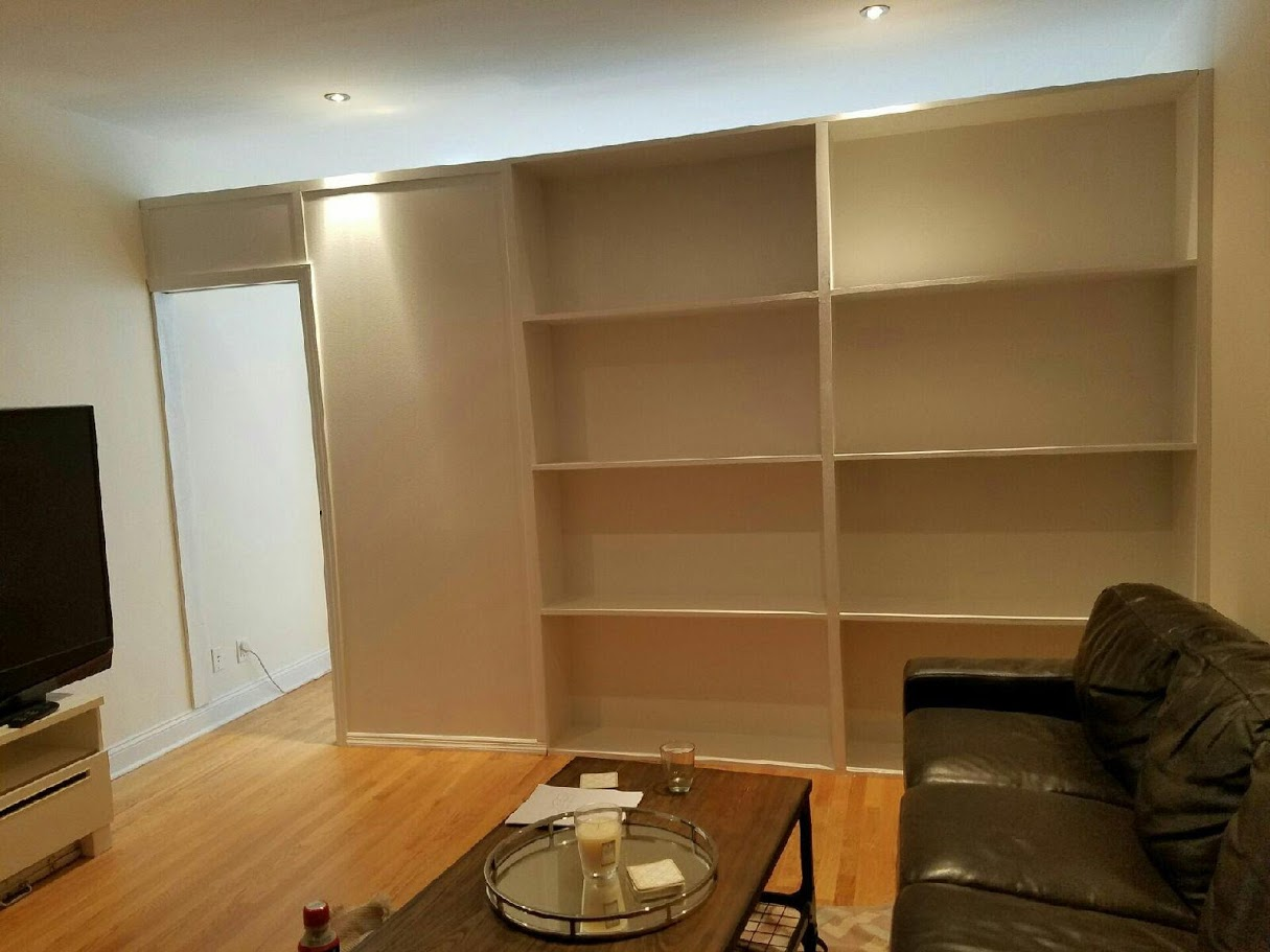 This Wall From 2 NY Sports Two Sections Of Shelves With A Pocket Door And Can Be Customized To The Required Distance Ceiling