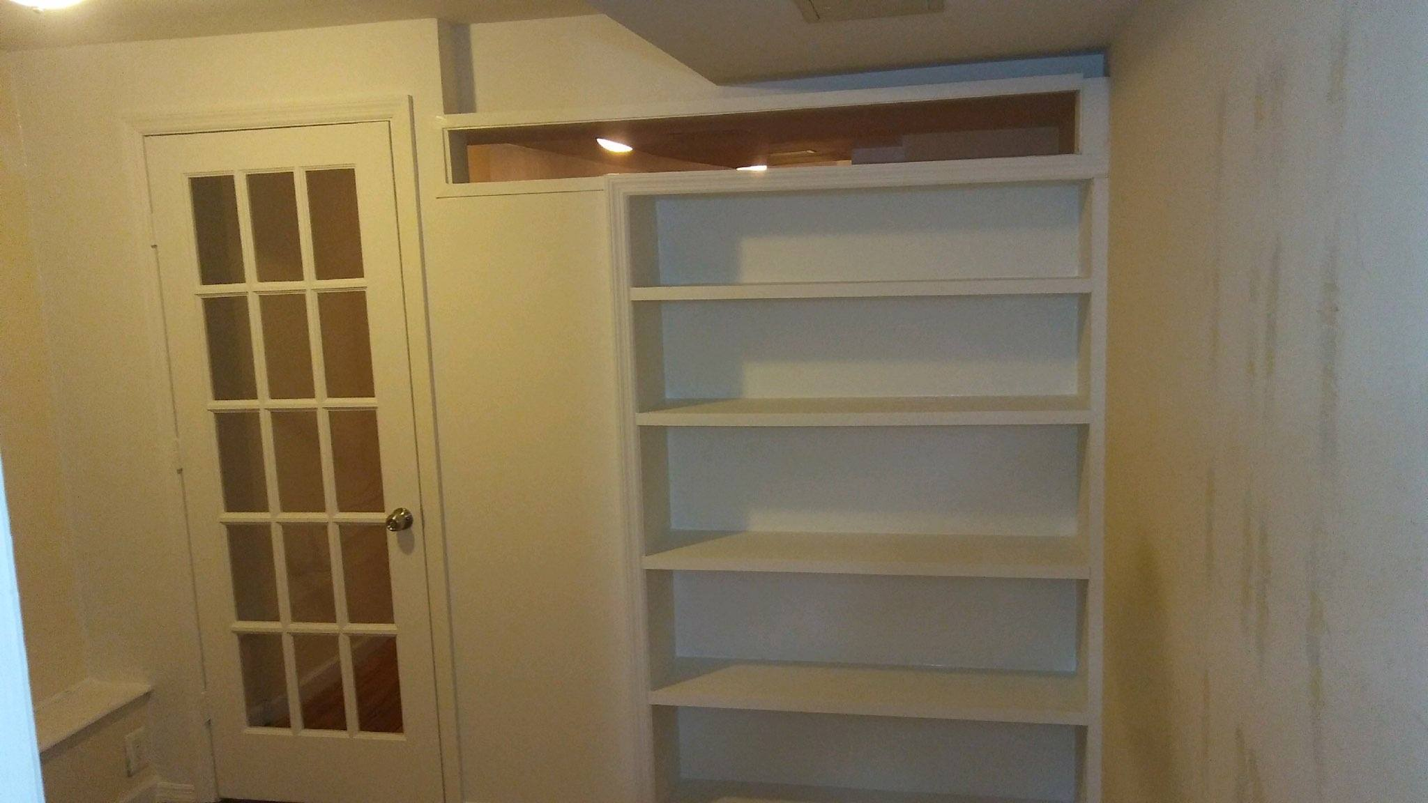 Wall 2 NYs Bookcase With A French Door And Plexiglass Transom Is Custom Job That Allows For Both Privacy Light Cost 1850