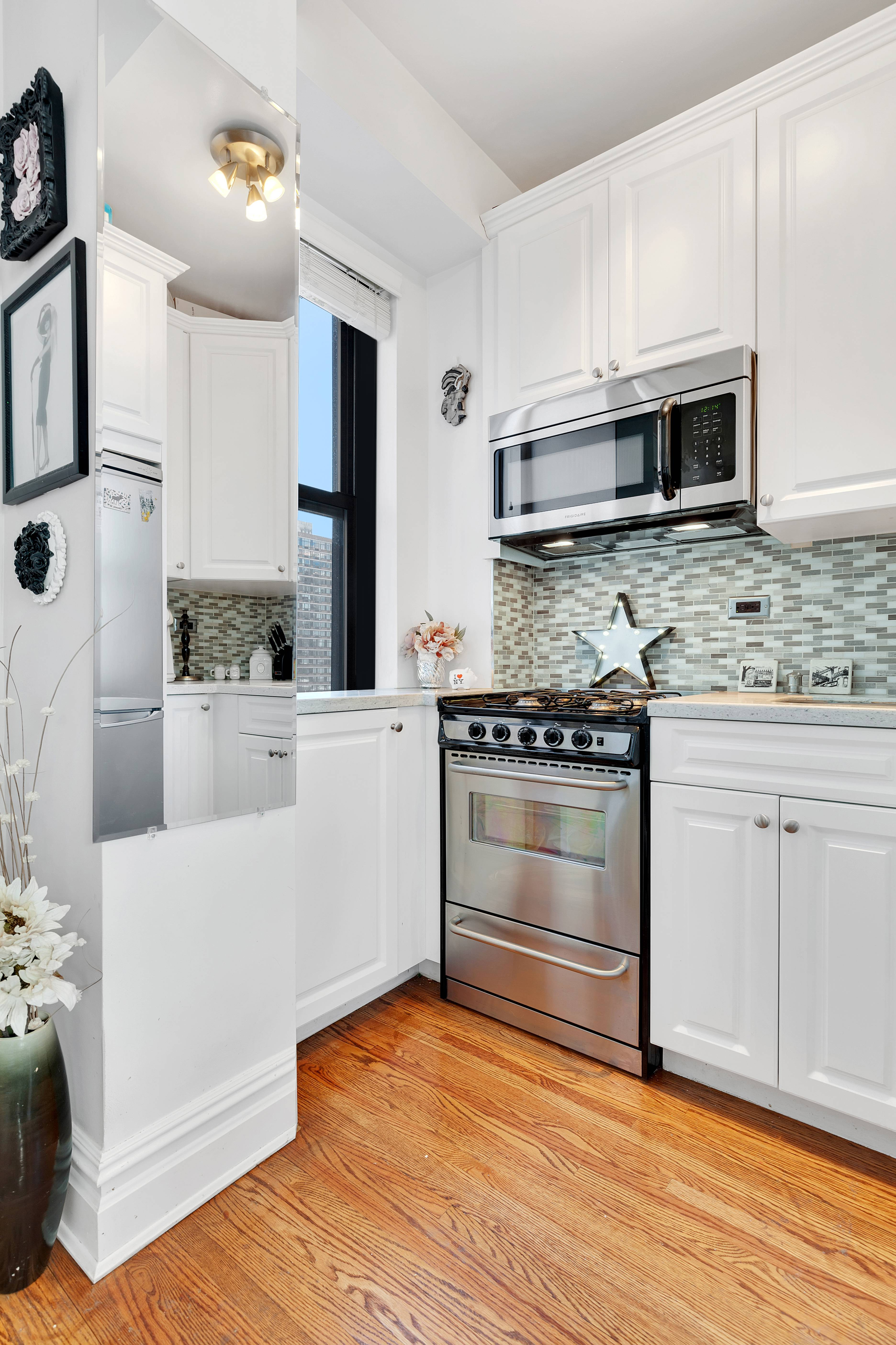 as for the apartment itself its unusually light filled for a midtown studio with windows on both sides of the main living area as well as in the kitchen - Lincoln Center Kitchen