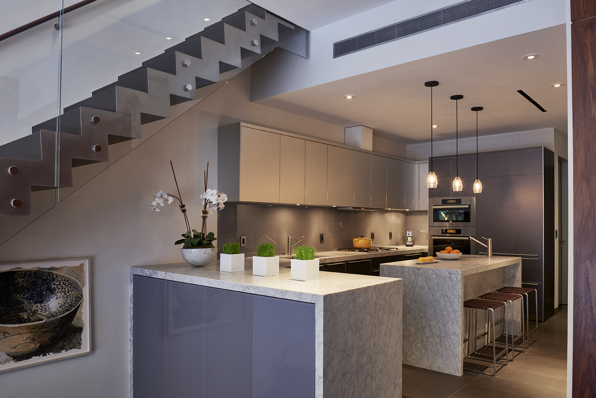 What are waterfall kitchen islands and how do I use them in an open