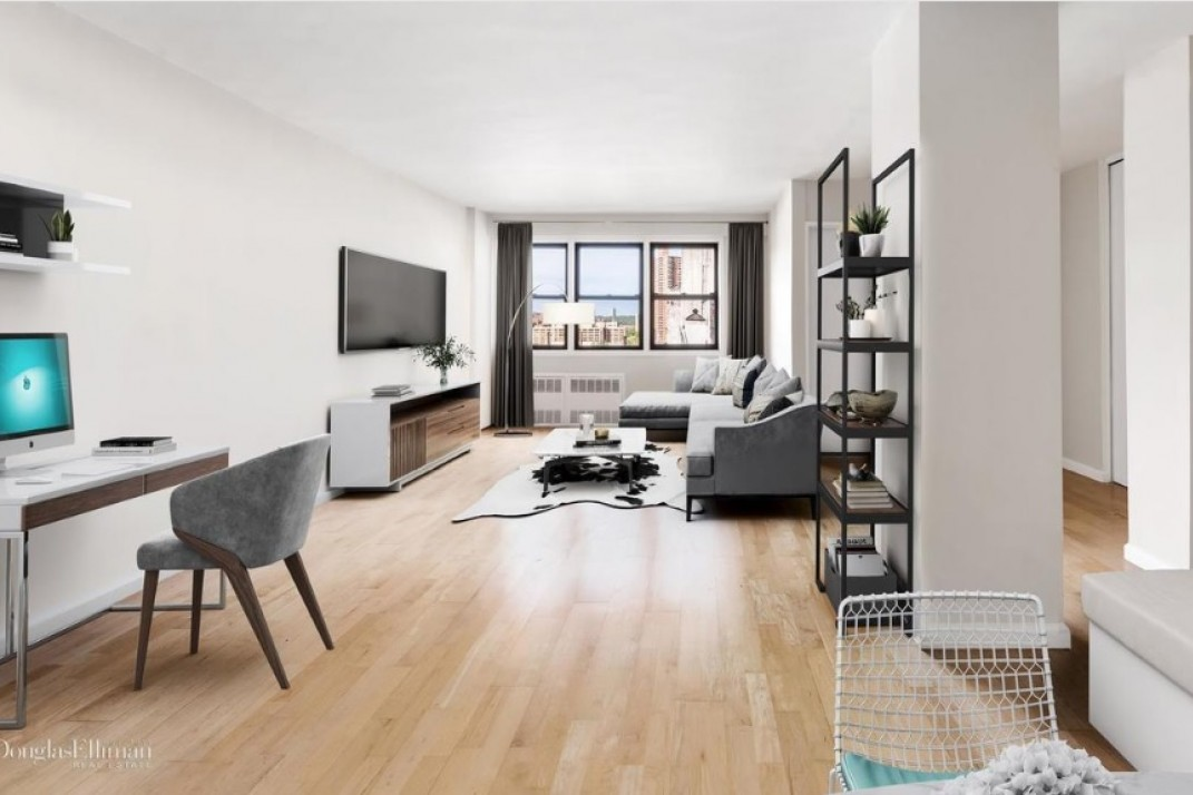 A renovated studio with a separate sleeping alcove in Inwood ...